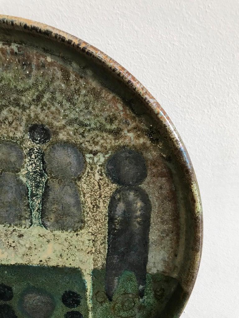 Italian ceramic plate or centerpiece marked Vanna Faenza on the bottom, circa 1960s.