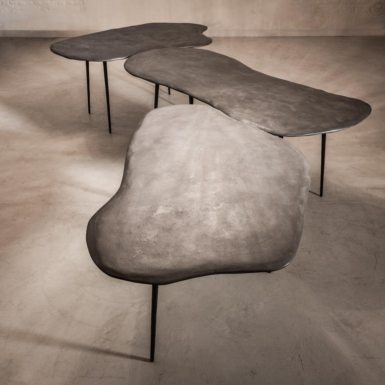 Varenna table Trio by Studio Emblématique Dimensions:  - W 157 x D 92 x H 76 cm - W 162 x D 95 x H 76 cm - W 200 x D 85 x H 76 cm Materials: Stonegrain table top with conical metal hammered legs  Pushing the boundaries, going the extra mile
