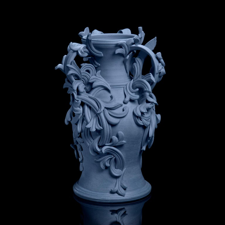 Vari Capitelli IX is a unique handmade colored stoneware ceramic sculptural vase in blue by the British artist Jo Taylor. The central form has been thrown on the potter's wheel and also hand-built, then adorned with architectural inspired flourishes