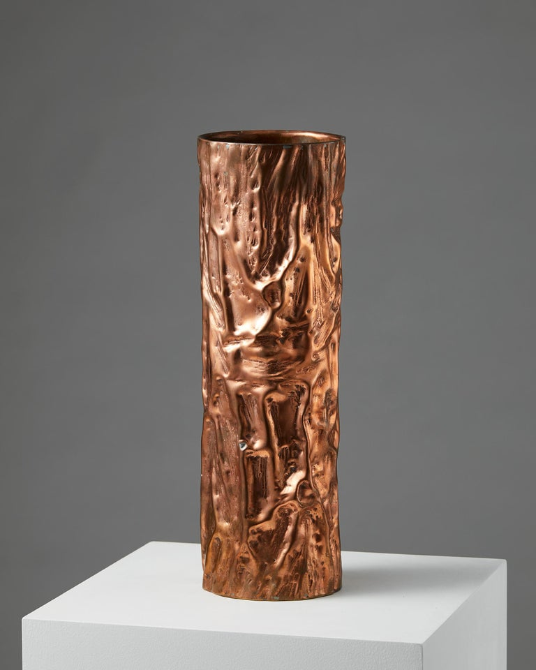 Solid copper on brass.