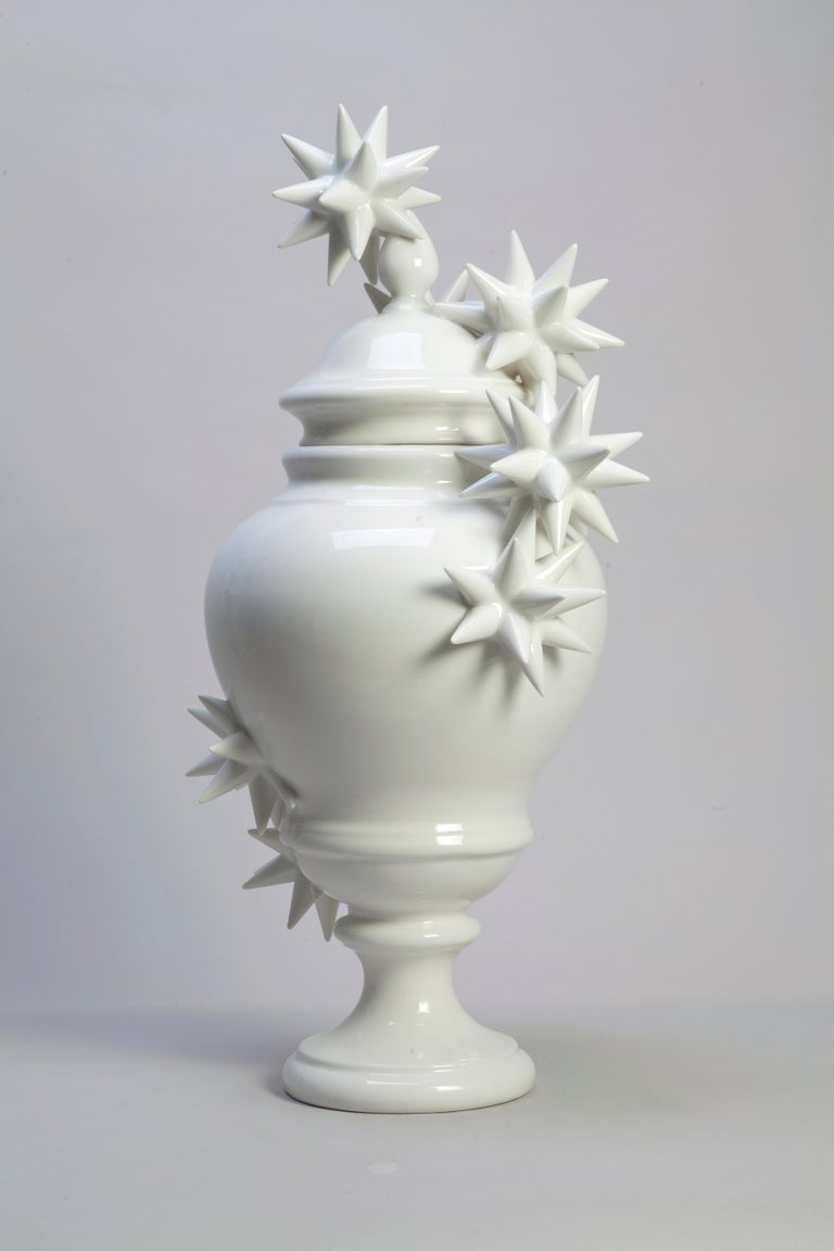 White vase with stars, unique piece, 2017, glazed earthenware, 36 x 76 cm height  Andrea Salvatori (Italy, 1975) is a visual artist working in ceramics to realize ironic and witty sculptures, sometimes involving a diverse selection of found objects,