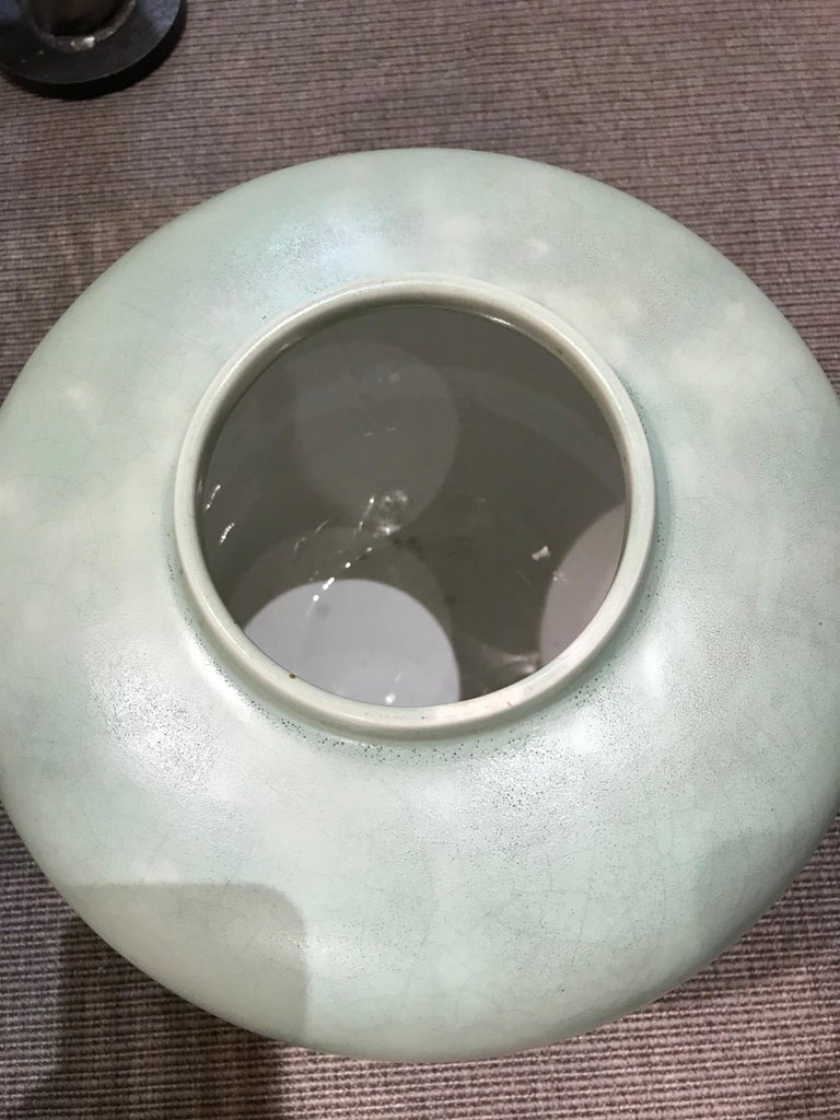 Round vase with a small opening, covered in a deep celadon glaze.   OUR REFERENCE N10282