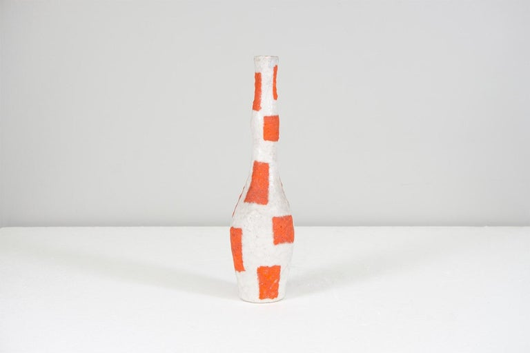White and orange ceramic vase