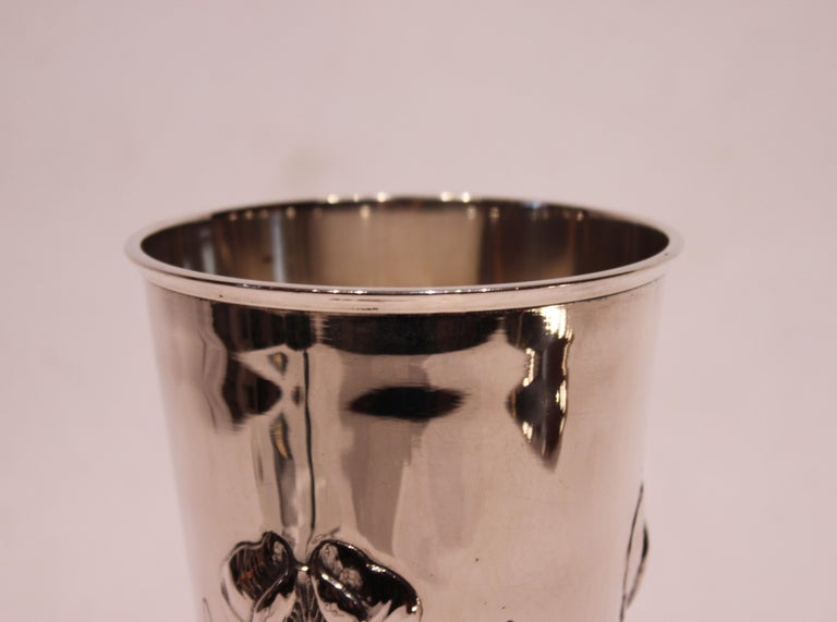 Vase decorated with flowers and of hallmarked silver. The vase is in great vintage condition.