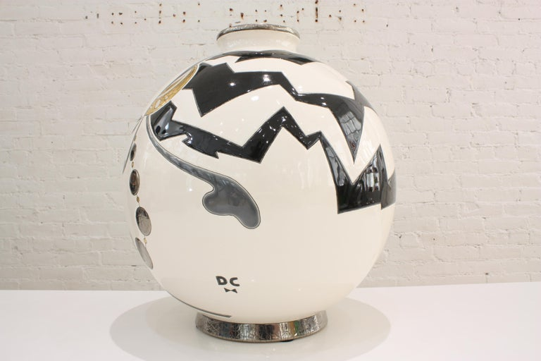 Superb round vase in limited edition in Art Deco style. The artist Danillo Curetti was commissioned by Les Emaux de Longwy to create this design for their world famous Boule vases.   Black and white, gold 21.7 carat, platinum 18.7 carat  Limited