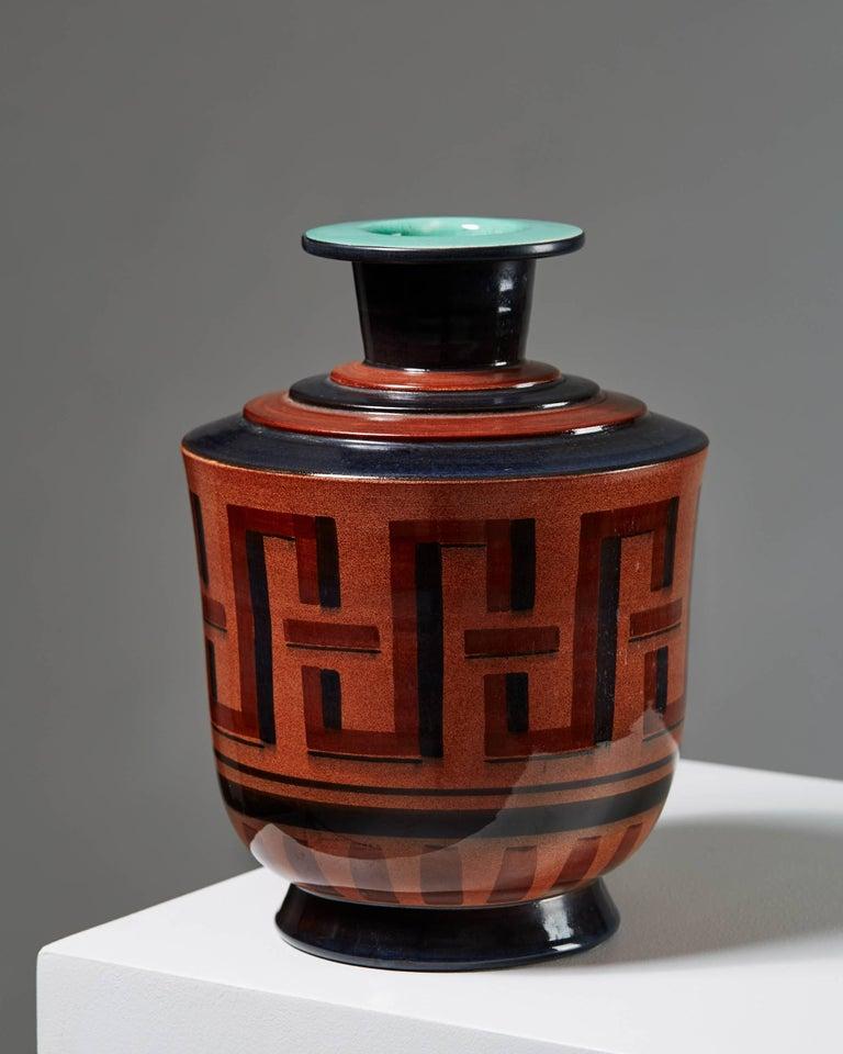 Stoneware.  Measures: H 25 cm/ 9 3/4