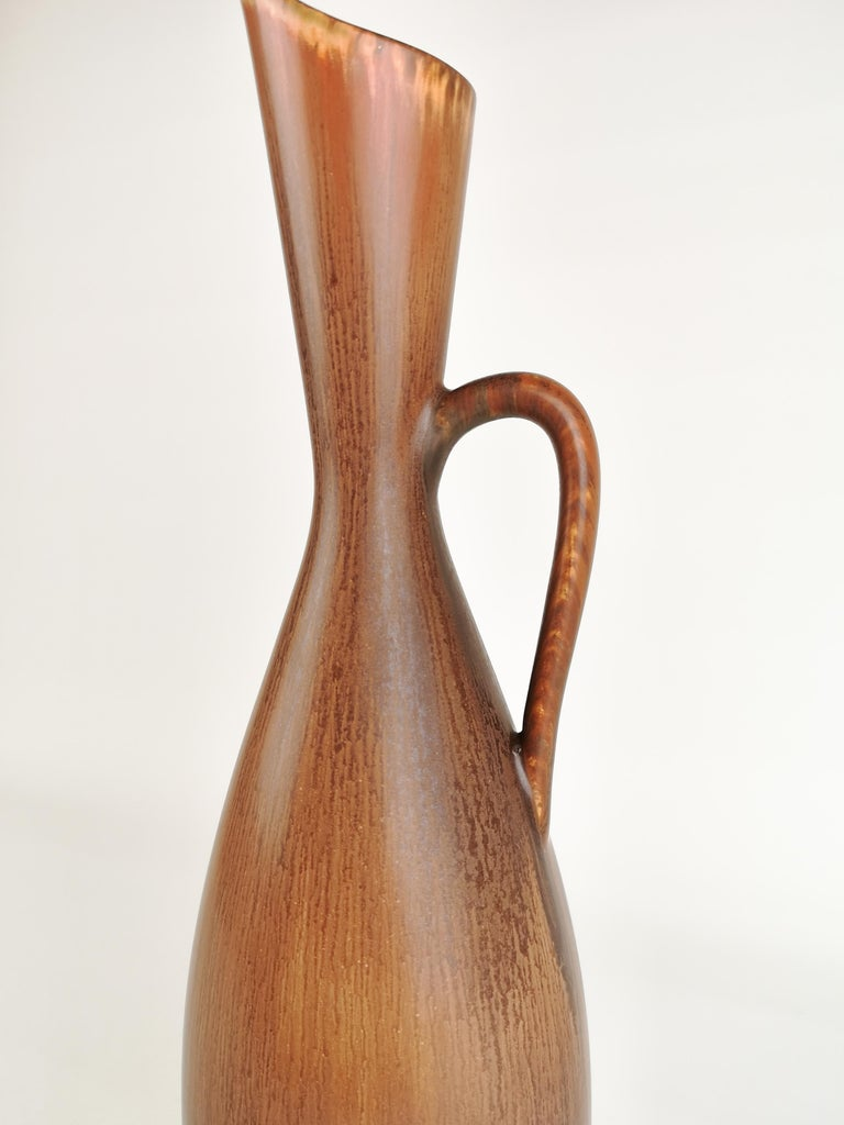 Very nice large vase from Rörstrand and maker/designer Carl Harry Stålhane. Made in Sweden in the midcentury. Beautiful glazed vases in good condition.