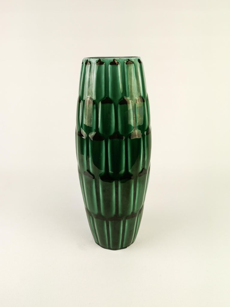 A wonderful vase produced by Upsala Ekeby Sweden designed by Anna-Lisa Thomson 1951. Wonderful green glace with pattern of artichoke.  Very good condition. Small traces of wear on the bottom