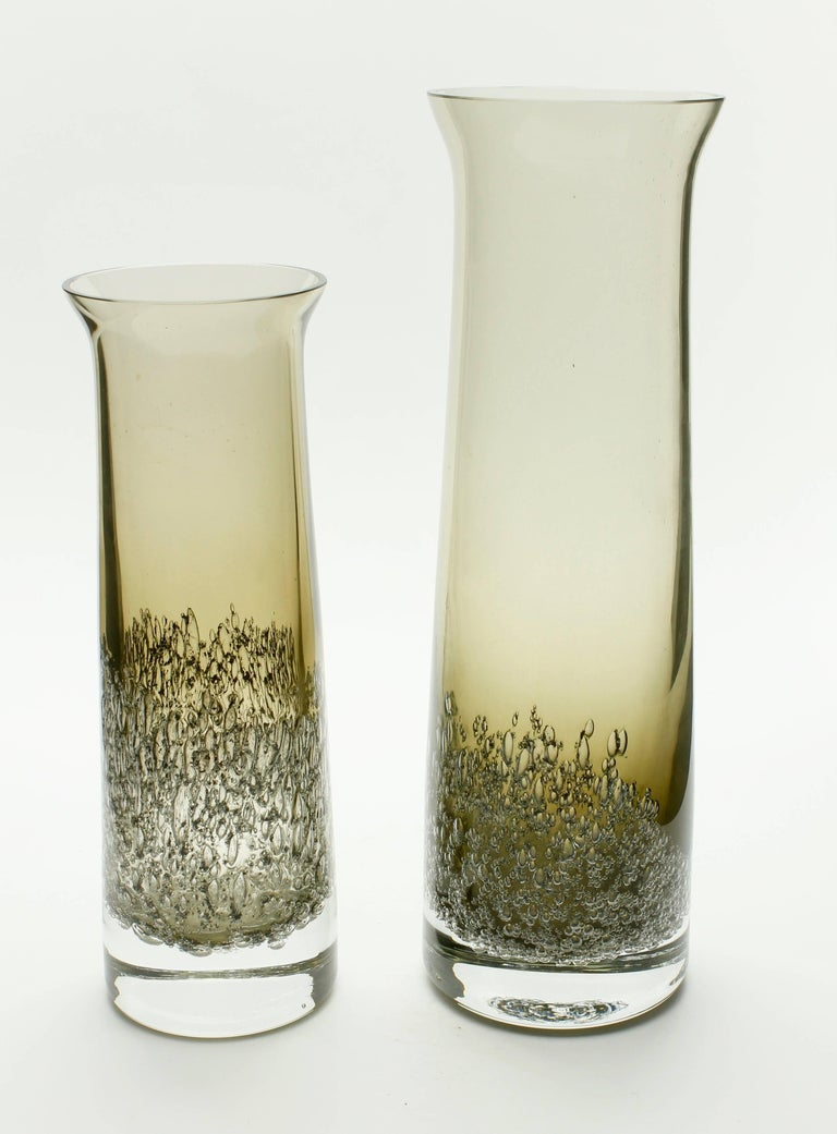 Designed by Heinrich Löffelhardt and manufactured by Schott Zwiesel. Heinrich's design activity was at its Zenith during the 1950s-1960s. He became especially interested in the use of potash and other chemical additives which create bubbles in the