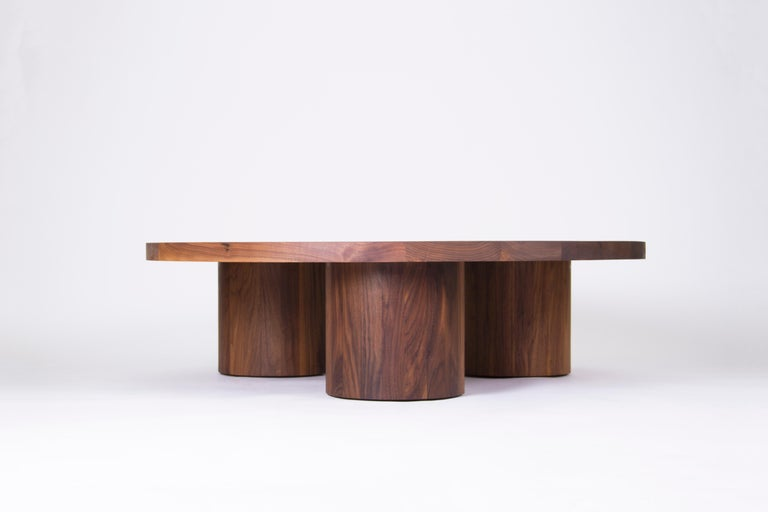 Vassoio coffee table in solid wood with circular insets and wide cylindrical legs.  Available in solid walnut, white oak, red oak, maple, ash or black stained ash.  Finished with a clear protective coating.  Designed and handmade in Los