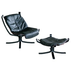 Vatne Falcon Lounge Chair with Ottoman in Black Leather and Red Piping