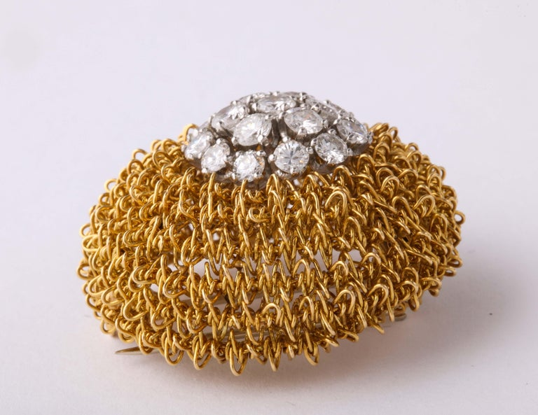 Elegant and super chic for that late afternoon Cocktail at The Ritz.   18kt Woven Gold Pin with 19 clean & very white Full Cut Diamonds - prong set - and slightly asymmetrically set on the Clip.  Around 4 carats total.  Marked VCA 6518K  Made in