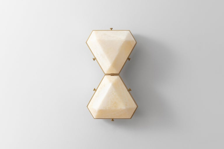 The Vega Due is a geometric, modular, contemporary lighting fixture. Vega is suitable for installation on the ceiling as a flush mount, or on the wall as a sconce. The body is made from extruded aluminum with brass accents. The diffusers are
