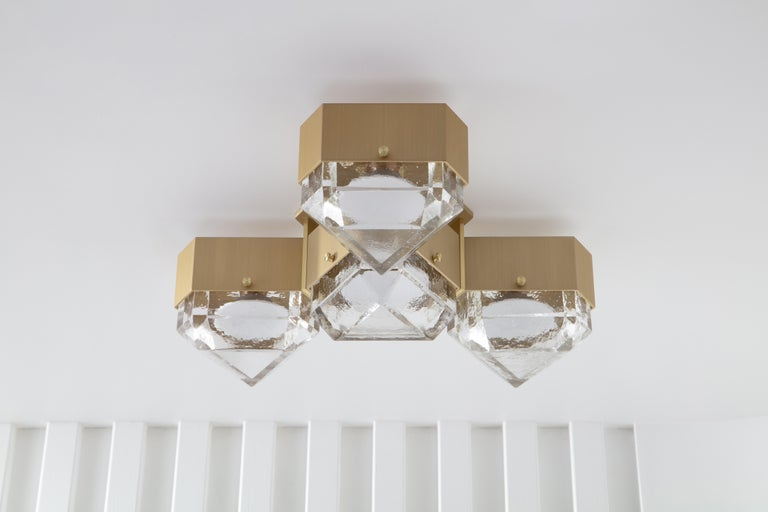 Vega is a geometric, modular, contemporary lighting fixture. The body is made from extruded aluminum with brass accents. The diffusers are available in cast glass. No external driver is necessary since Vega is outfitted with fully dimmable, warm
