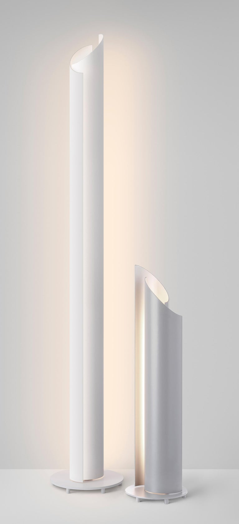 The new Vella series is a dynamic family of luminaires designed to be completely adjustable via two independently swiveling louvers, inviting the user to sculpt light and shadow. Vella's sweeping curved aluminum form subtly captures and releases