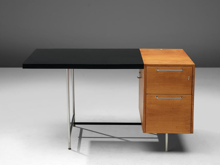 Velox, desk, oak, chromed metal, Poland, 1960s  This desk consists of a tabletop and a drawer cabinet. The wooden cabinet stands on two chrome feet. It has two drawers with two chrome handles. The first drawer may be locked. The black tabletop is
