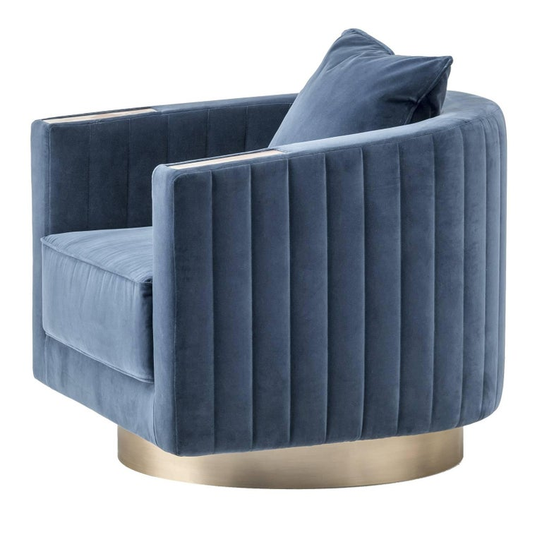 Clean lines and luxurious details are the hallmarks of this superb armchair designed to take center stage in any decor. The Minimalist profile is enhanced by the square wooden frame accented with dark Horn details on the front corners of the