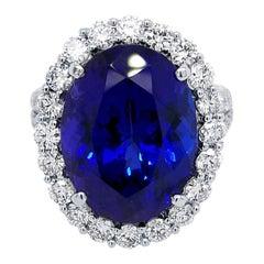 Velvet Blue Oval Tanzanite Split Shank Pave Set Engagement Ring with Halo