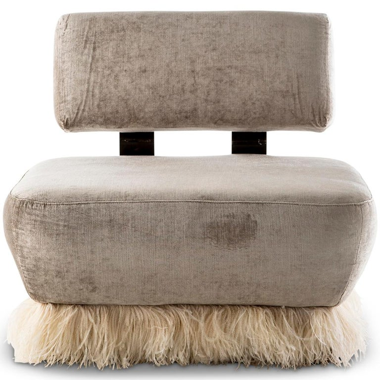 This lounge chair is part of the Ostrich Fluff collection designed by Egg Designs and manufactured in South Africa. The lounge chair is constructed in two section, these are connected via two bronzed steel brackets which are then fixed with solid