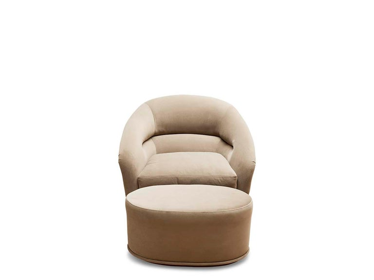 The Huxley swivel chair is inspired by 1970s lounge furniture. A curvaceous form with a single line tuft and long seat cushion rest atop a brass base that swivels.  The Lawson-Fenning collection is designed and handmade in Los Angeles,