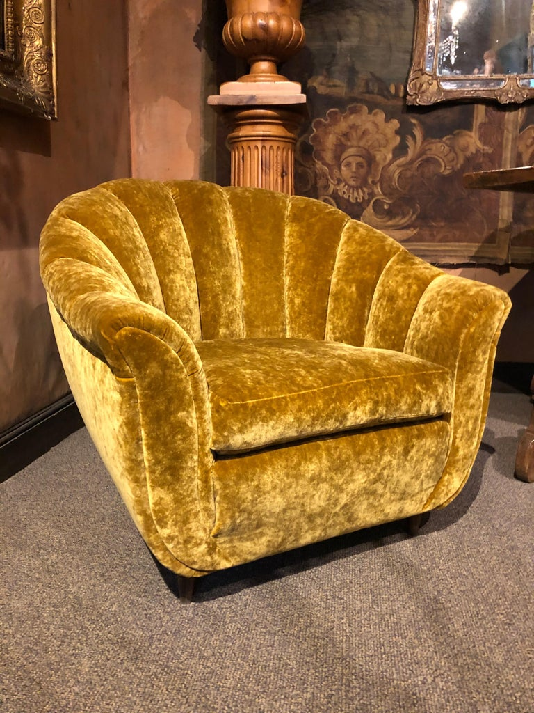 Re-upholstered with a golden mustard changing velvet fabric. Wooden leg. Seashell shape, circa 1940 Italy  Sofa Height : 31.4 in  Seat height : 15.7 in Length : 81.8 in Depth : 25.5 in  Pair of armchairs, each  Height : 32.2 in Seat