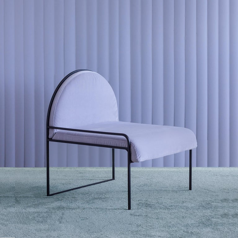 The sw chair in violet sky finds a delicate softness within its stark minimalism and pure geometric form. Dressed in crisp velvet upholstery on a simple arched steel frame, the chair is both striking in its architecture and subtle in its quiet