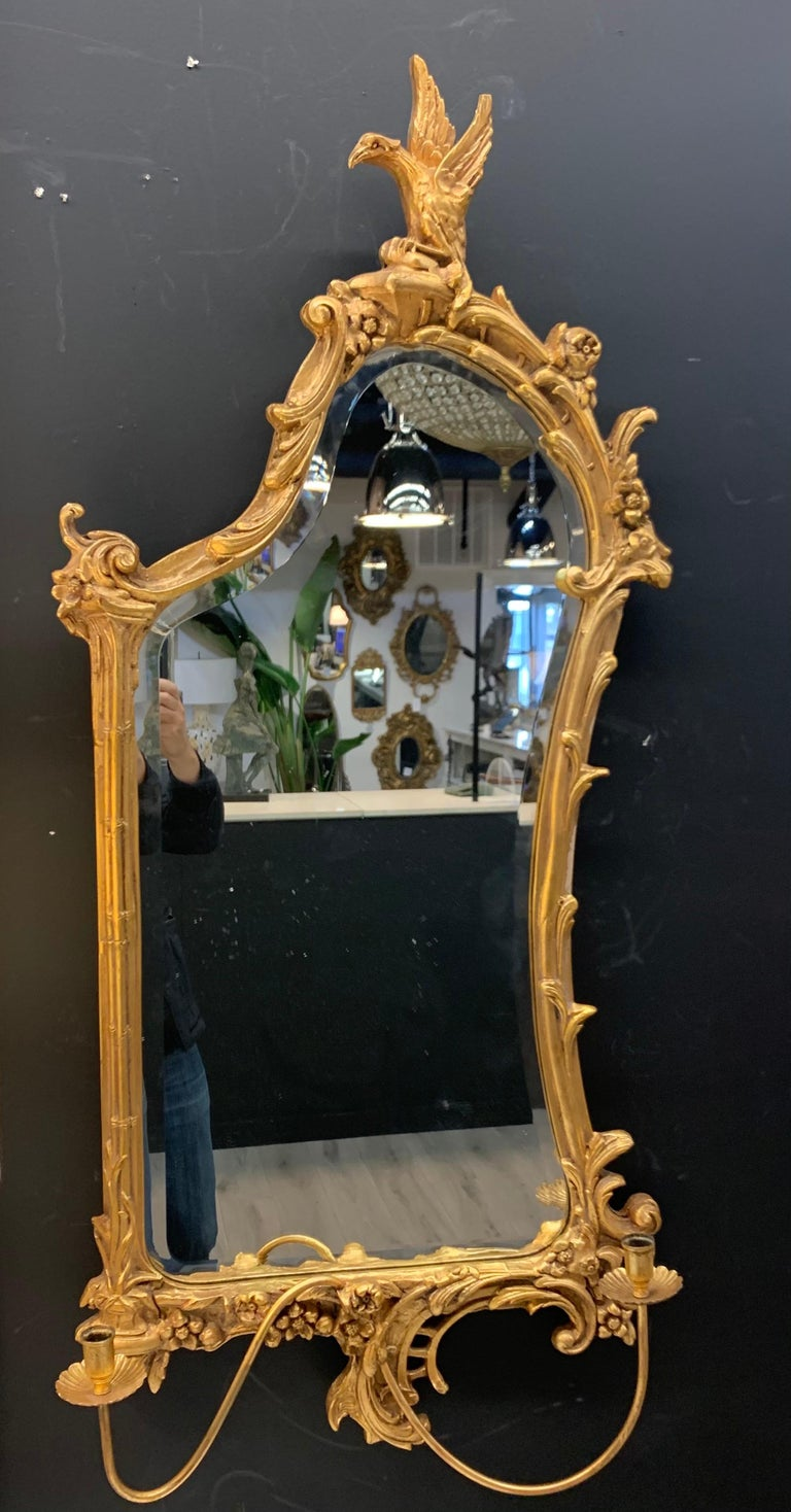 The mirror was likely made in the early part of the 20th century but in the same Italian region, and appear to have a more Japanese influence in their design especially the hawk/eagle leaning over the top of the mirror. The giltwood frame of the