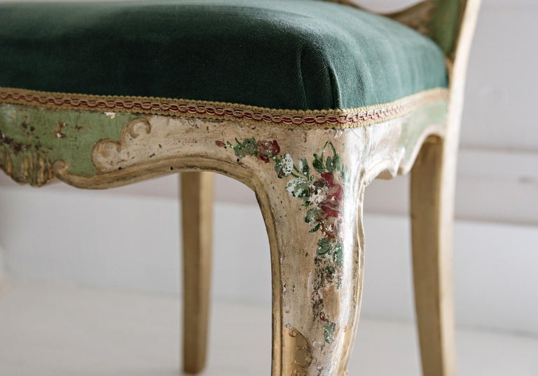 Elegant Venetian chair with carved, lacquered, gilded and hand painted wood with floral decorations.