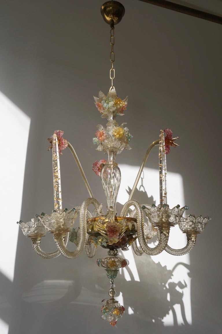 Venetian hand blown opaline Murano six-light candle chandelier with vibrant floral colors, crown canopy, centered bulbous column, scrolled arms with the original crown bobeches, and finished with a decorative vibrant floral lower pendant. Chandelier