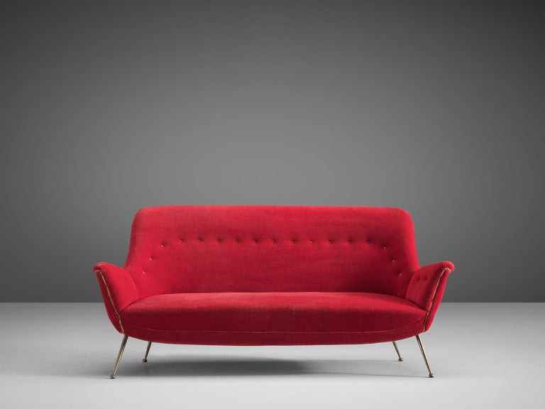 Sofa, red fabric and metal, Italy,1950s.  This gorgeous Venetian sofa is an iconic example of Italian design from the 1950s. Organic and sculptural, this two-and-a-half-seat sofa is anything but minimalistic. Equipped with the original stiletto