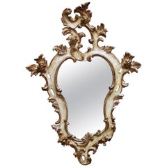 Venetian Rococo Revival Ivory Painted and Parcel-Gilt Cartouche-Shaped Mirror
