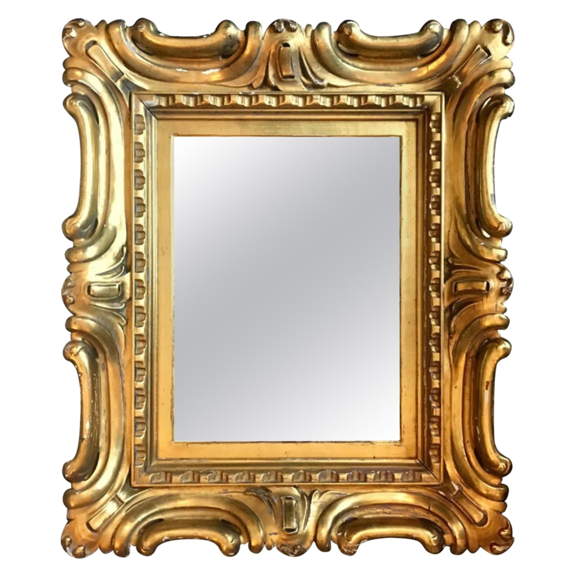 Venetian Sansovino Palatial Early Baroque Style Carved and Gilded Mirror
