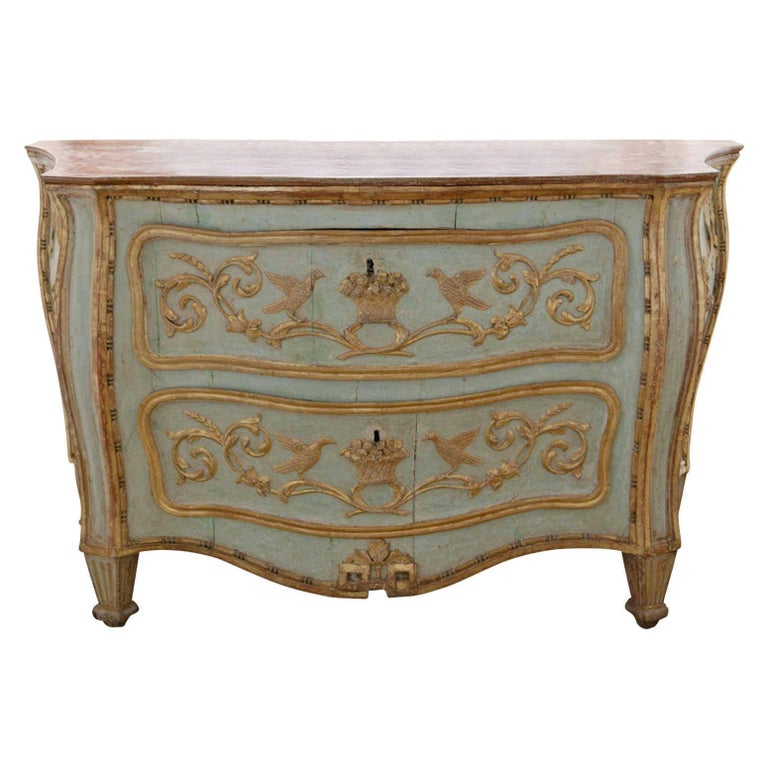 Two-drawered Venetian-style painted chest of drawers of the 18th century. The trapezoidal body stands on short fluted feet and used to be opened from the sides. These doors were sealed off and two drawers were integrated in the front. The chest is
