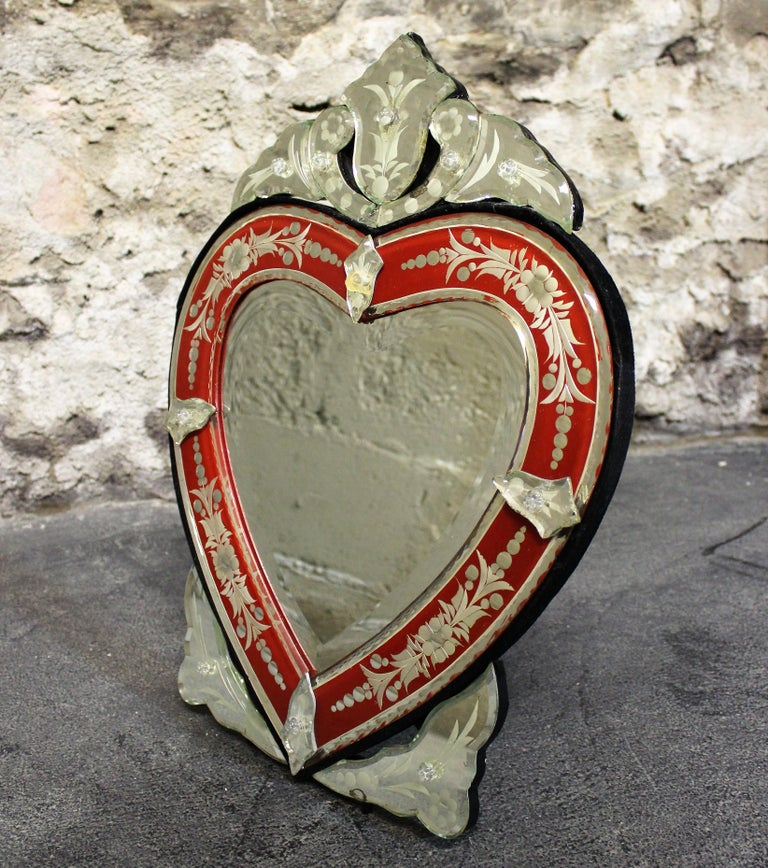 This vintage Venetian mirror is designed to be mounted to a wall or sit on a tabletop.