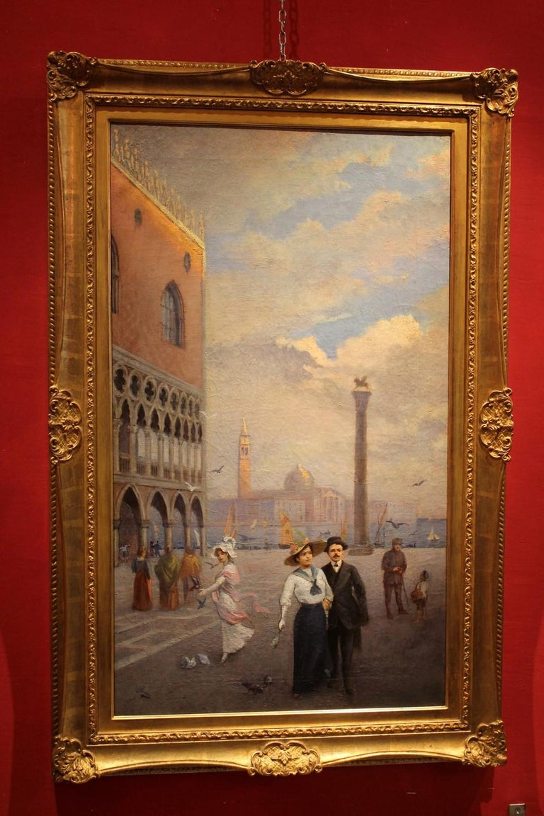 This delightful turn of the century (late 19th-early 20th century) oil on canvas painting represents an Italian landscape with one of the most famous squares in the world: Piazza San MarCo in Venice. The rectangular canvas paints the square from an