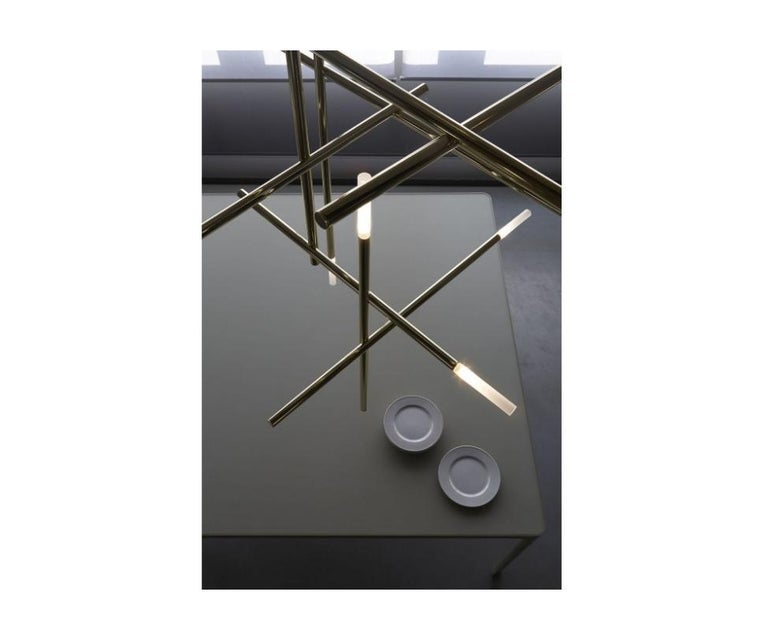 Floor sample sale item  Venicem Kitami suspension designed by: Massimo Tonetto  The Kitami Suspension Light is an exciting design of lighting engineering and craftsmanship. The pendant hangs like a series of conductor batons that are music to