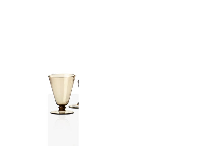 Ambasciata set of blown handmade glasses, designed and manufactured by Venini, features a straw yellow color. Six different glasses available plus a decanter. Originally designed in 1925. 2 pieces per box. Indoor use only. Ambasciata sciroppo: Ø 9