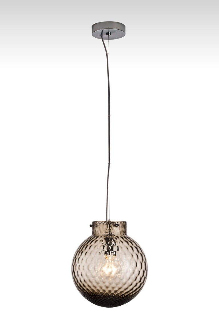 Swing light, handmade blown glass.  Year of Manufacture: 2014 Alogena 1 x max 70W E27 Suitable for CFL Metal: Chromium Plated Other Color Available: Apple green, Aquamarine, Horizon, Red Measurements: Ø 9.84
