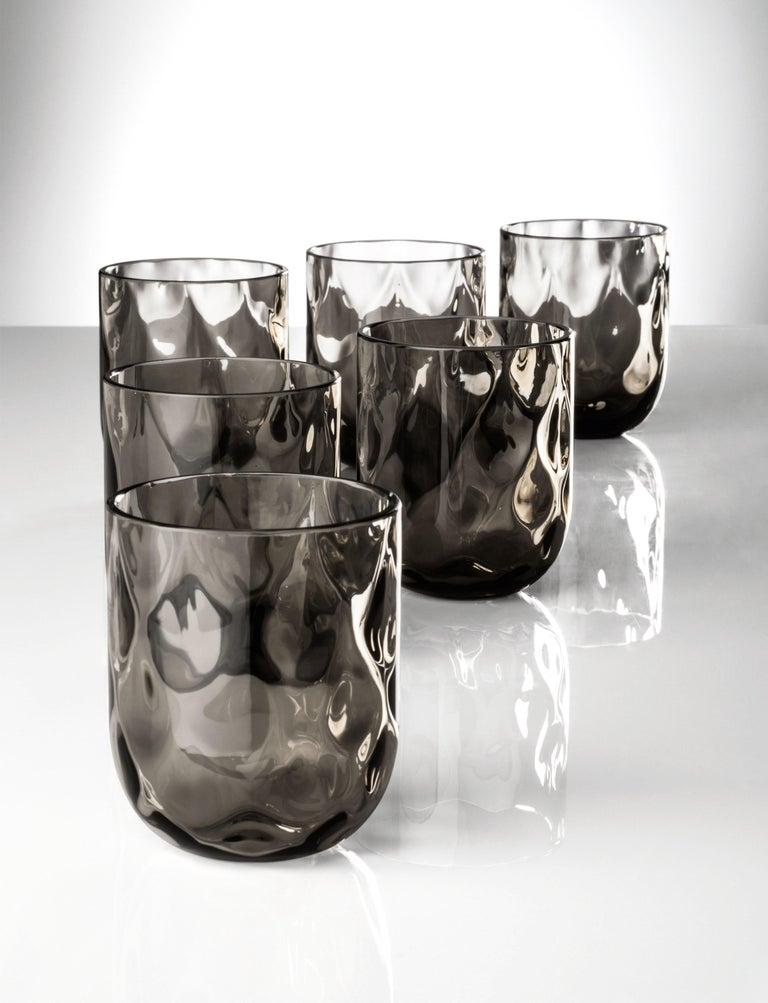 Bicchieri Carnevale glass set, designed and manufactured by Venini, consists of 6 Murano glass glasses.  Dimensions: Ø 8 cm, H 9 cm.