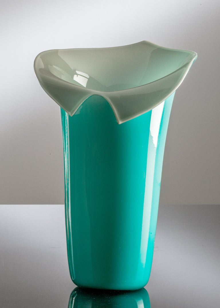 Calla glass vase, designed and manufactured by Venini, is a limited edition of 99 art pieces in mint green / grey color. Indoor use only.