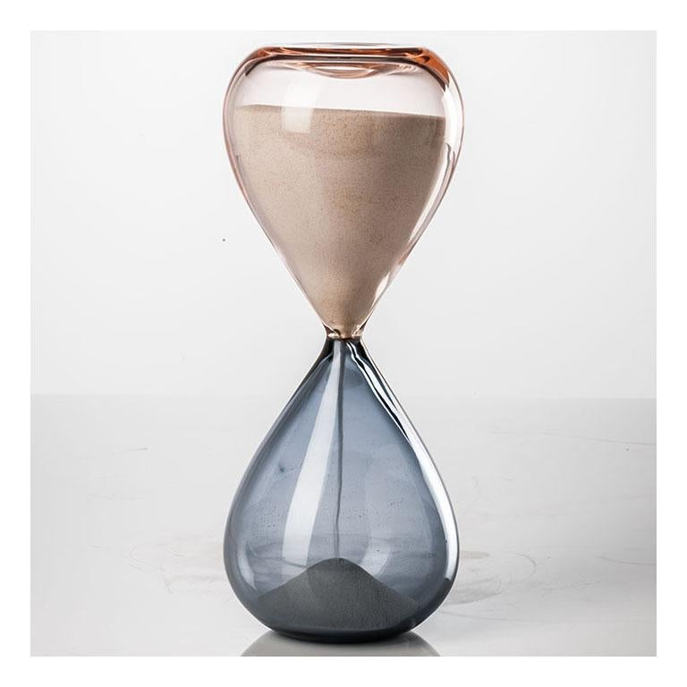 Clessidre Hourglass, designed by Paolo Venini and Fulvio Bianconi, was originally designed in 1957. Available in different colors, the grey / mint green version is a limited edition of 99 art pieces. Indoor use only.  Dimensions: Ø 10 cm, H 25 cm.