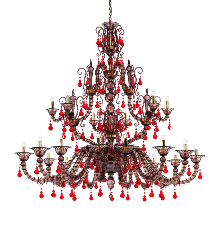 Diamantei four-tier glass chandelier. An elegant and colorful addition particularly suitable for a living room or entrance space. Also available in other colors.