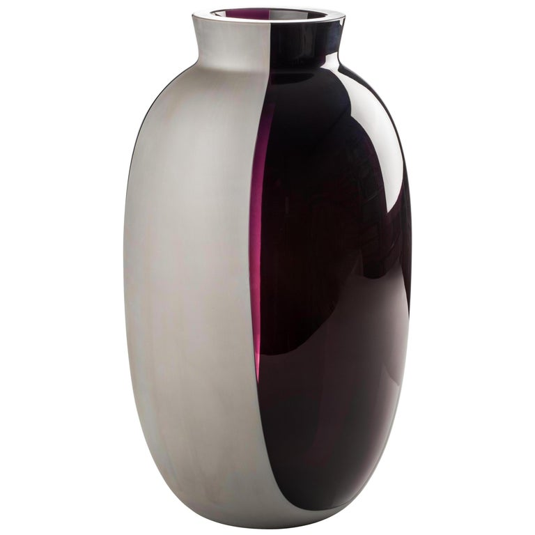 Koori vases, designed by Emmanuel Babled and manufactured by Venini, feature a concrete band melted with the glass. Numbered edition. Indoor use only. Color: Transparent violet/ concrete band satin finish.  Dimensions: Ø 22 cm, H 38 cm.