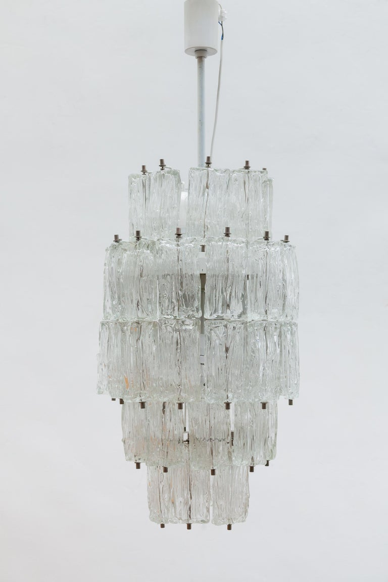 A very rare set of three large 1960s Italian clear structure iced Murano glass chandeliers designed by Toni Zuccheri for Venini, 1960s, Italy. The skeleton interior and hardware is white lacquered. In original good condition.