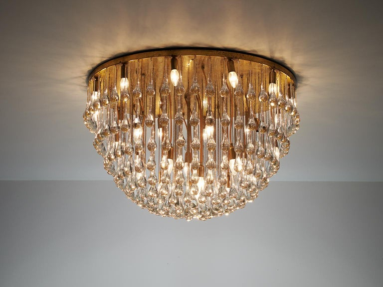 Chandelier in brass and glass, attributed to Venini, Italy, 1960s.  Majestic chandelier with a large amount of glass drops. This royal lamp creates a stunning light partition. The glass icicles combine together into a large globe. In combination