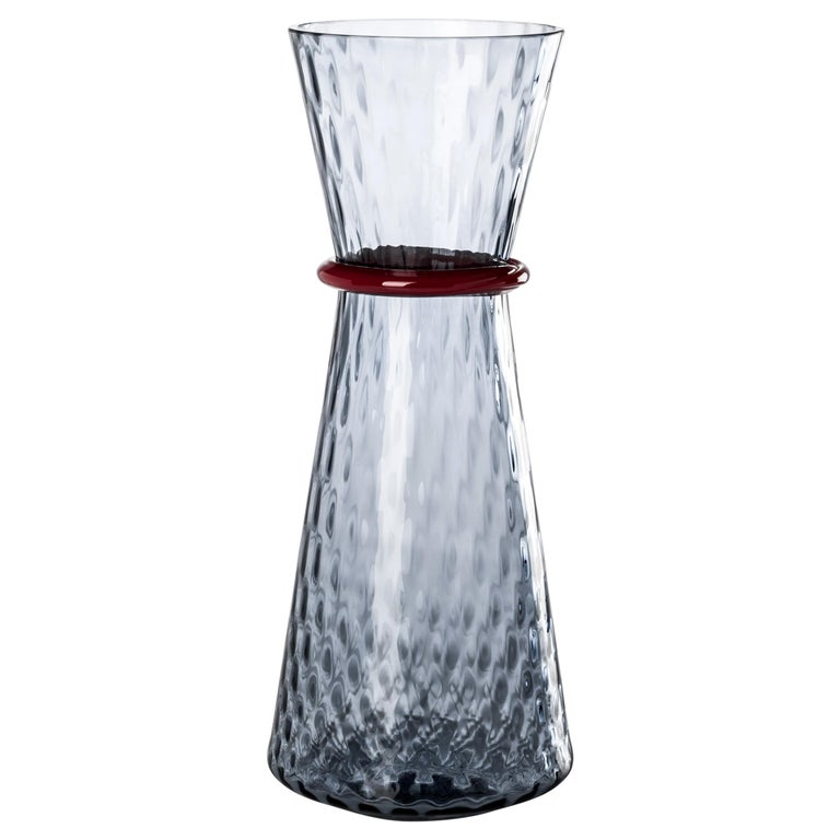 Tiara glass vases, designed by Francesco Lucchese and manufactured by Venini, is available in two different sizes. Indoor use only.  Dimensions: Ø 19 cm, H 46 cm.