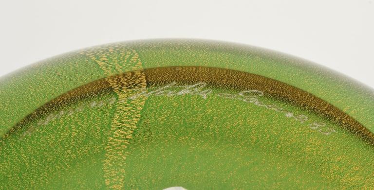 Venini Murano circular vase design by Laura Diaz de Santillana.   Vase description:  Colorless overlaid glass with a green intermediate layer and gold foil.   Inscribed: Venini Italia Laura 85.