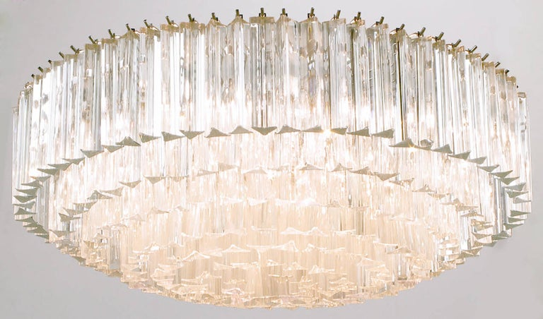 Large multi-tiered Murano glass crystal reverse wedding cake style chandelier by Venini. Chromed steel frame with 16 sockets. Measures: 32 inch diameter.