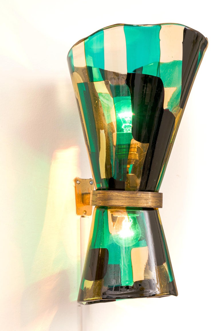 Pezzato glass was developed in the 1950s by Fulvio Bianconi for Venini & C. of Murano. The piece is covered with a patchwork of rectangles of different colors, heating the slices until the glass is soft and then picking them up and smoothing them to