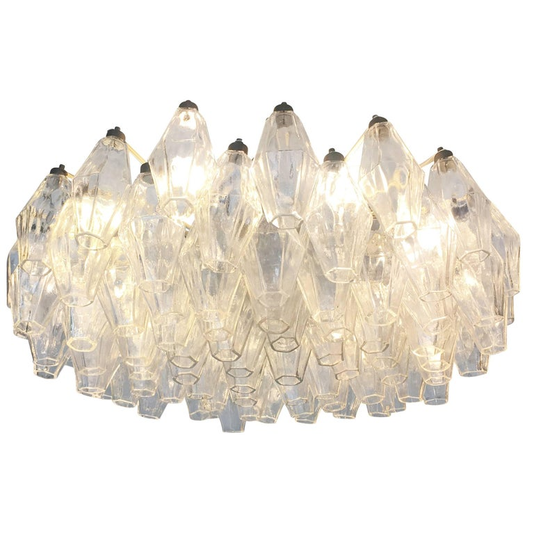 Original polyhedral chandelier made by Venini in the 1960s. This timeless Murano fixture has clear hand blown glasses on an off-white frame. Some tinted glasses are available if one wished to add a pop of color. Can be semi-flush mounted or hung on